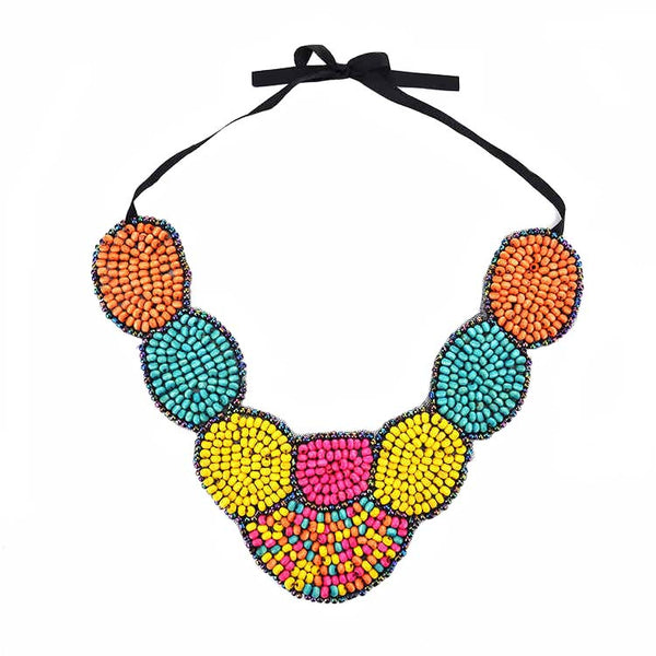 Intricately placed ceramic beads make this bold collar necklace the statement a must have.