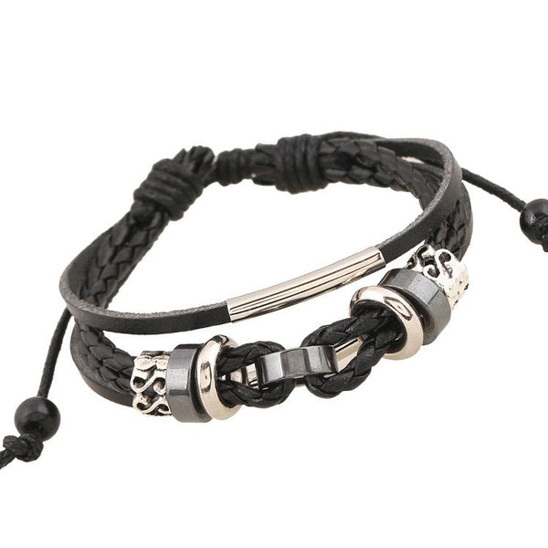 The simple and sleek silver adornments to this braided leather bracelet are a fun way to add intrigue to your ensemble.