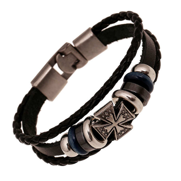 Made by hand, this vintage silver cross and braided leather bracelet adds a classic yet bohemian touch to your look.