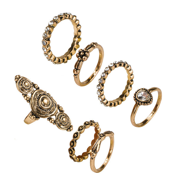 A gorgeous finger ring is accompanies by equally ornate vintage gold midi rings. Wear at once or separate. 7 pieces.