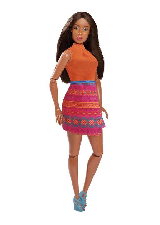 fashion doll with orange top and patterned skirt