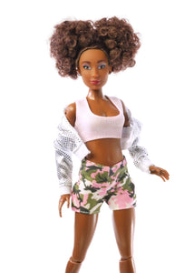 curly brown hair fashion doll wearing silver jacket pink top and camo shorts