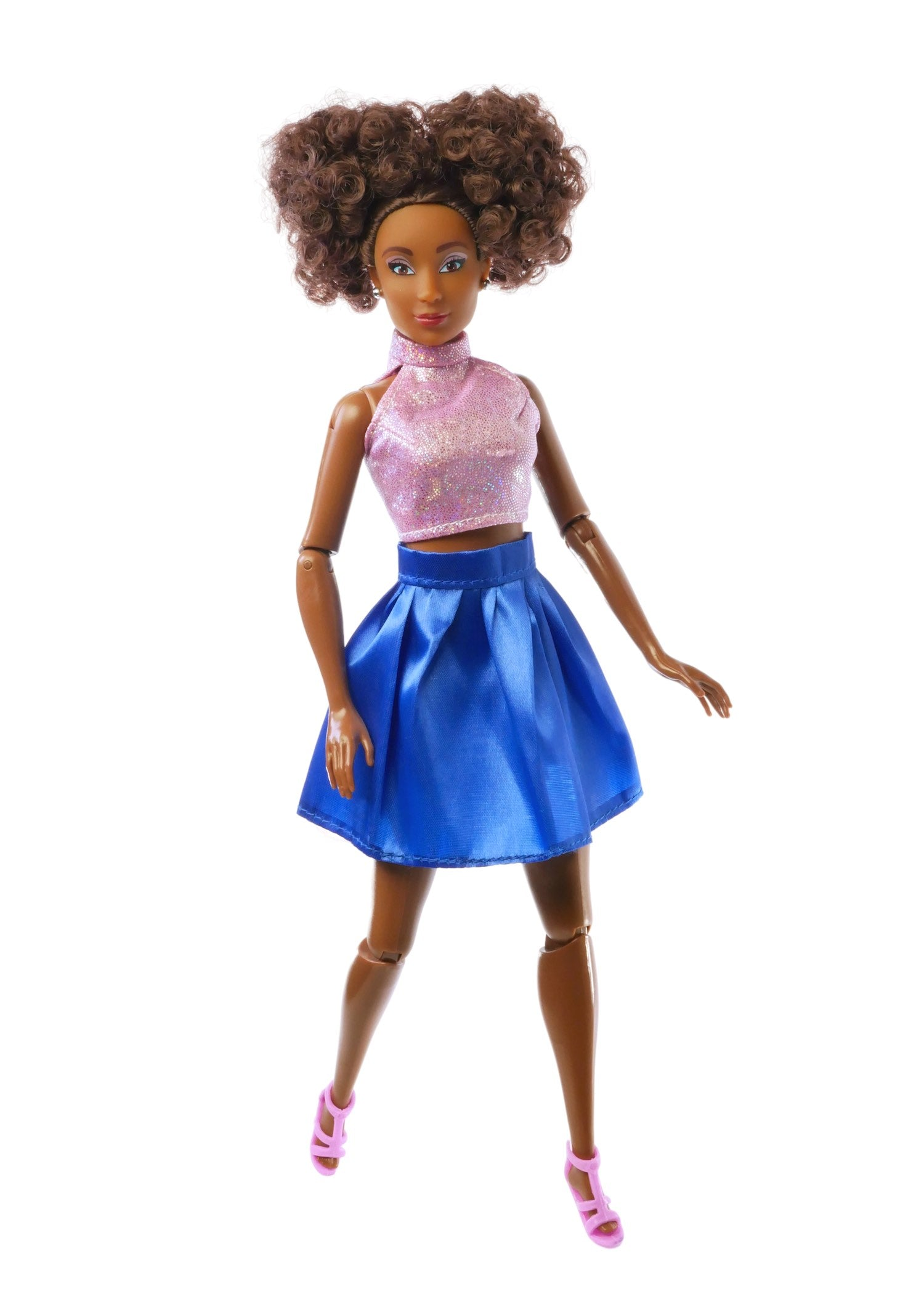 brown curly hair fashion doll wearing pink top and blue skirt