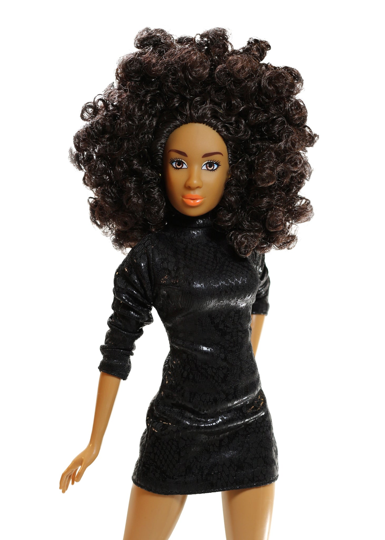 A fashion doll with curly hair and black dress.