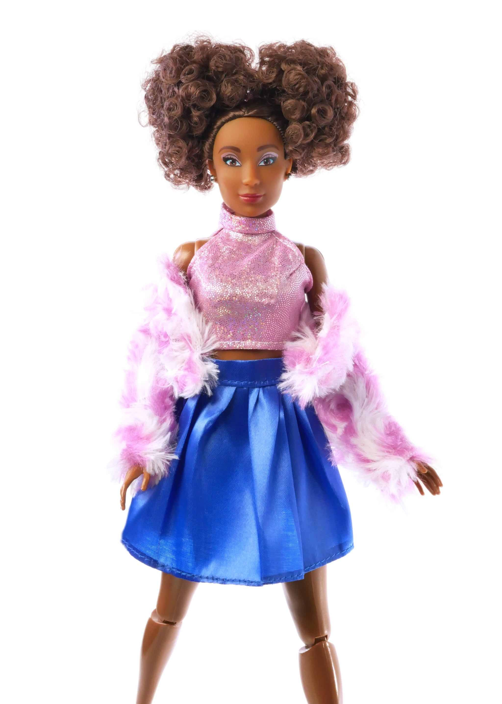 fashion doll brown curly hair with pink top, pink scarf, and blue skirt,