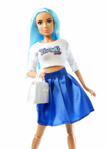 Up close blue haired fashion doll wearing white top with sleeves and blue skirt holding white purse
