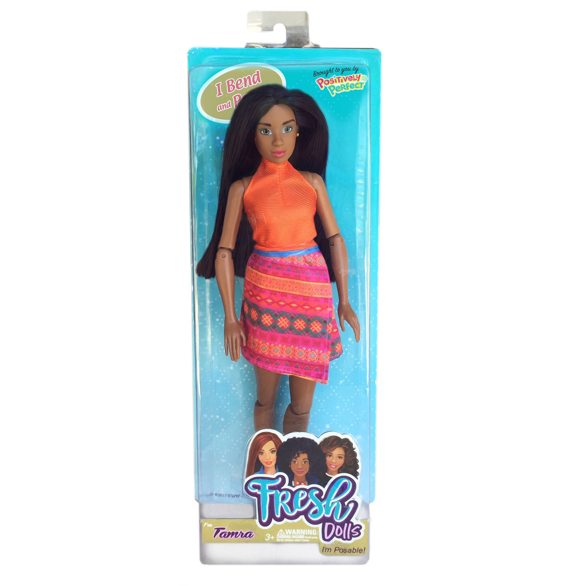 fashion doll with orange top and patterned skirt boxed