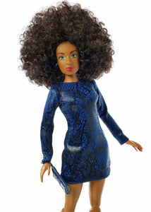 up close black curly afro hair fashion doll wearing dark blue dress with dark blue purse and black high heels