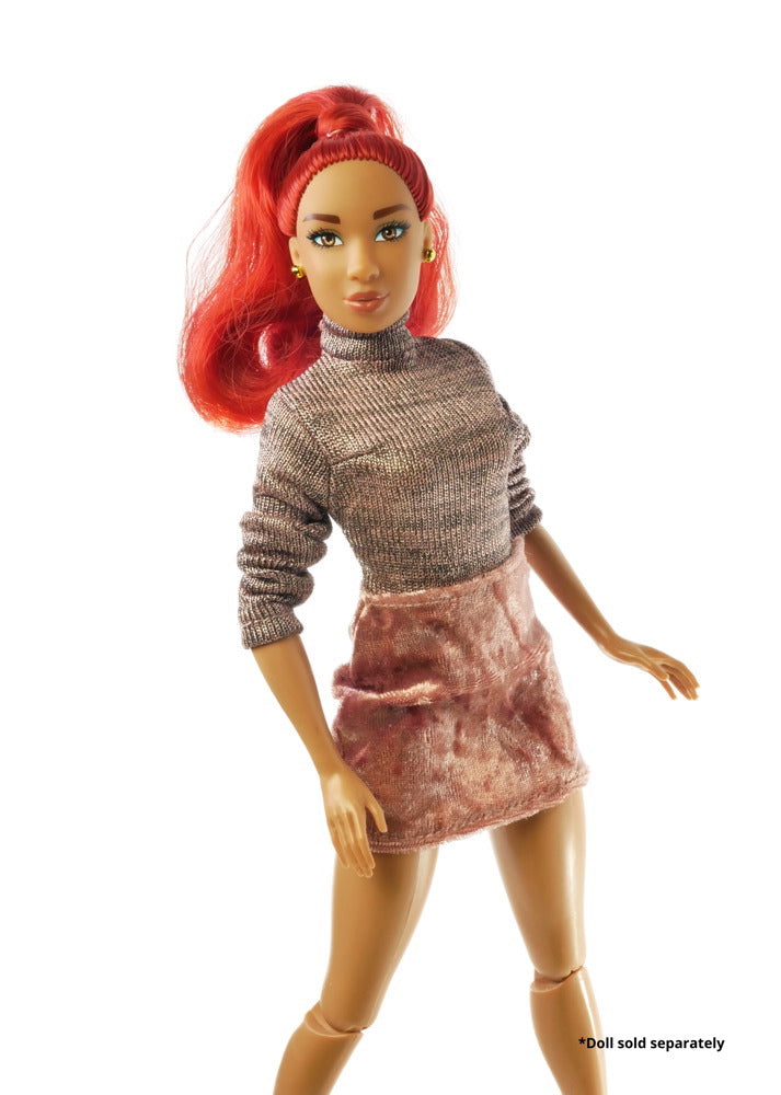 A fashion doll wearing the sweater dress.