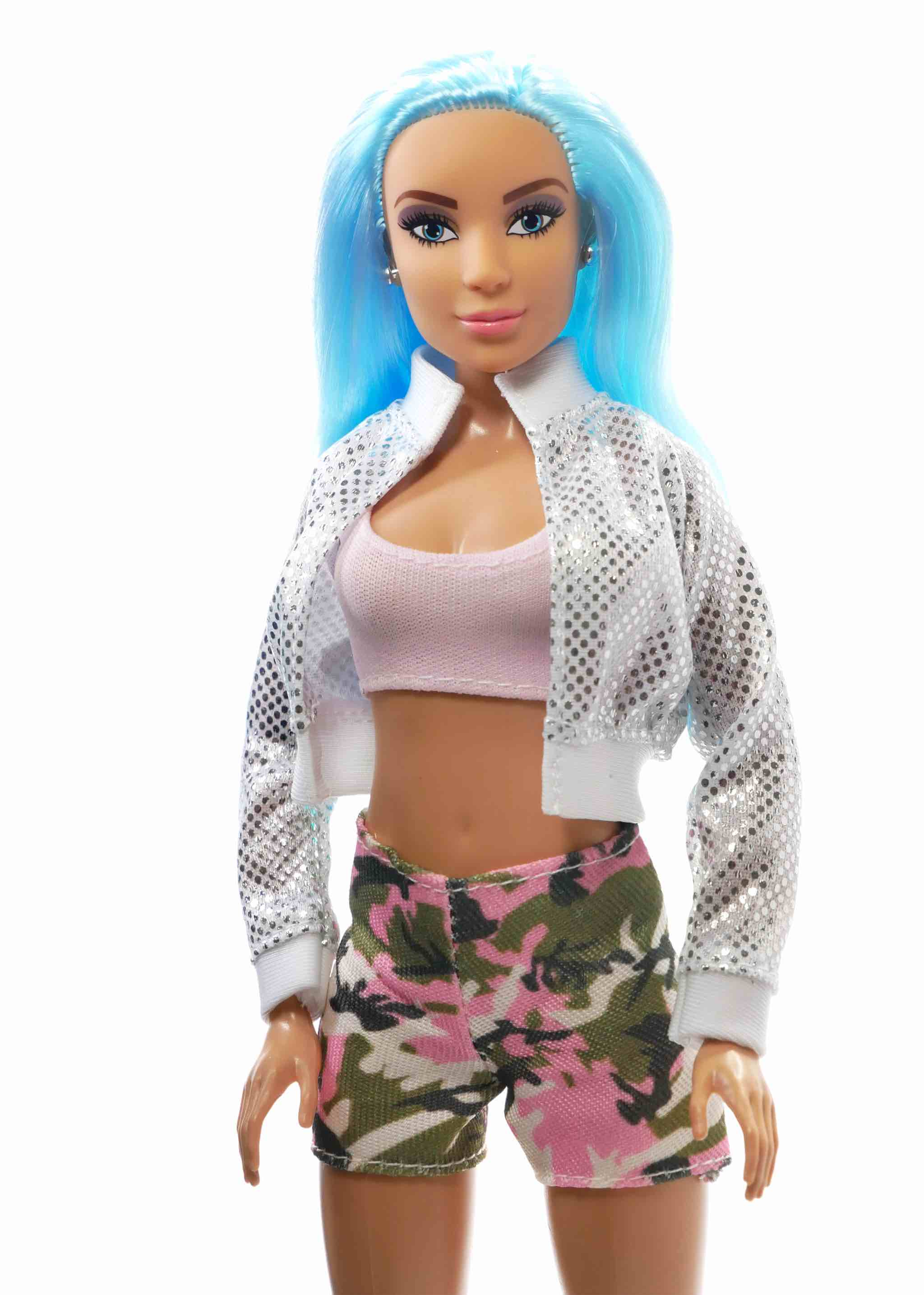 up close blue haired fashion doll wearing silver jacket pink top and camo shorts