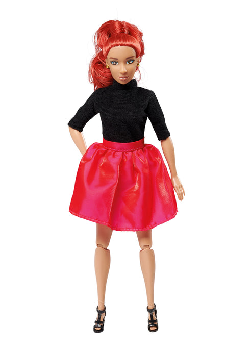 red hair fashion doll wearing black shirt and red/pink skirt