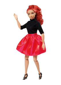 red hair fashion doll wearing black shirt and red/pink skirt posing