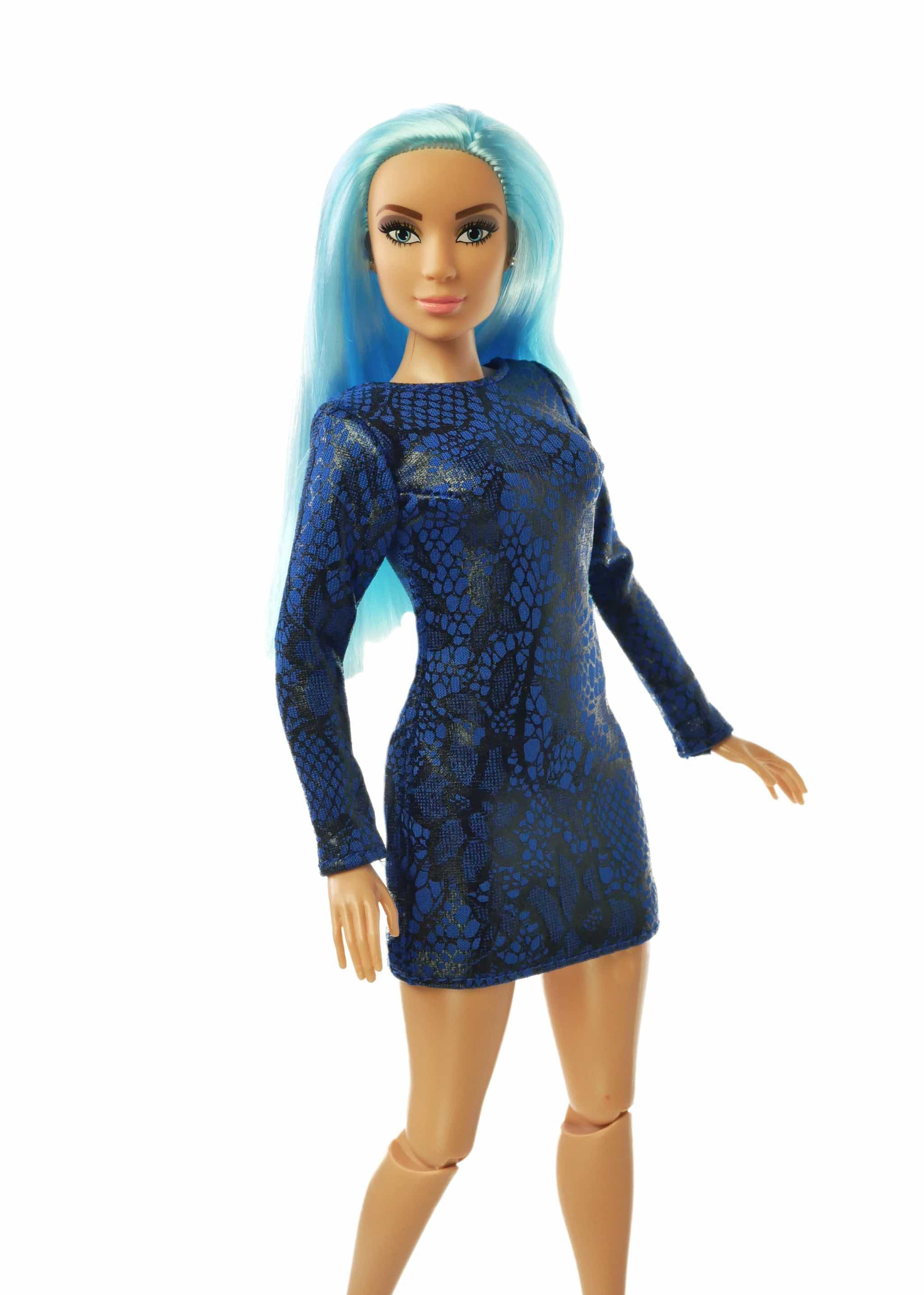 blue hair fashion doll wearing dark blue dress.