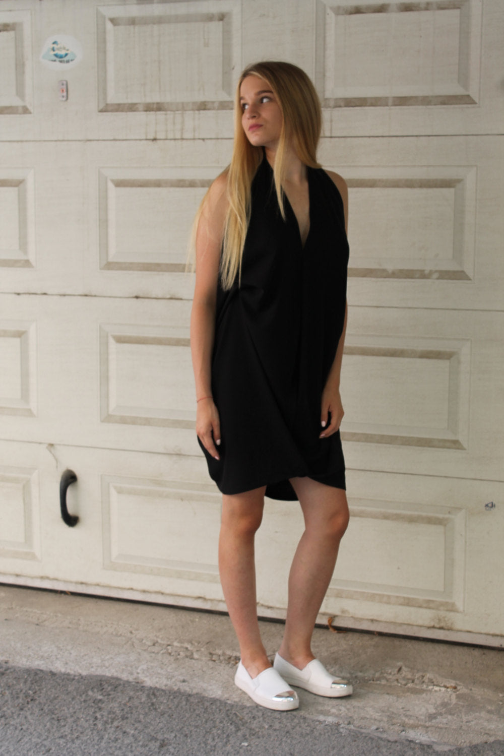 Voluminous bare back little black dress