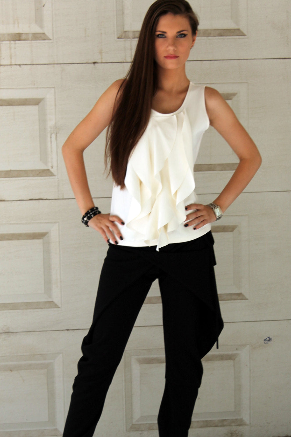 White sleeveless neoprene tank top with ruffled front
