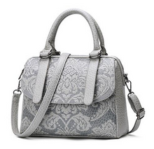Satchel with embossed floral design