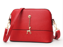 Shell high quality leather bag in solid colors.