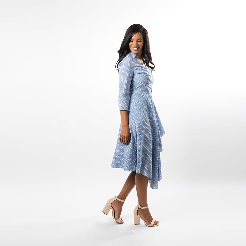 Not your ordinary shirt dress, this asymmetric hem wrap dress combines feminity with timeless classiness in a modern way.