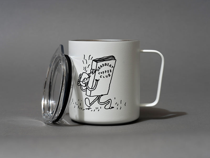 "Close up, lid off, detail. Insulated coffee cups featuring wrap-around illustrations by artist Stefan Marx. A book drinking a cup of coffee and a coffee mug reading a book. ""There's no money in books."" ""Deadbeat Club Coffee"" ""Deadbeat Club"""
