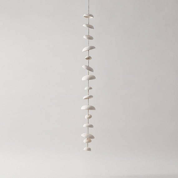 Mud Puppy Ceramic Moon Chimes - Full Strand