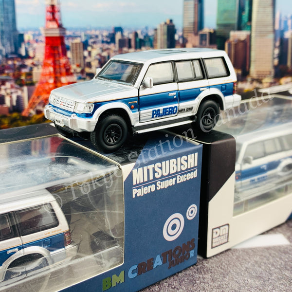 BM CREATIONS JUNIOR 1/64 Mitsubishi Pajero Super Exceed Silver with Blue Stripe LHD 64B0037
