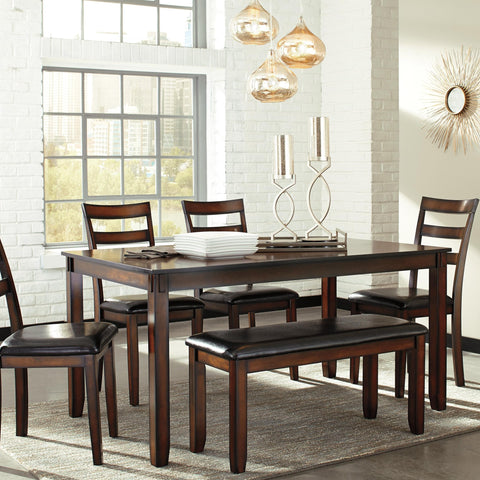 The Amador dining room table set's wonderfully clean-lined profile is dramatically enriched with a complex, burnished finish loaded with tonal variation and rustically refined character. Upholstered ladderback chairs are such a classic, while comfortably cushioned bench brings a modern sensibility to the table.