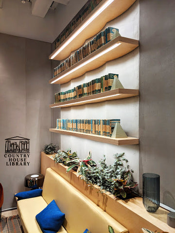 country-house-library-shelfie-we-works-london-pelican-books-design