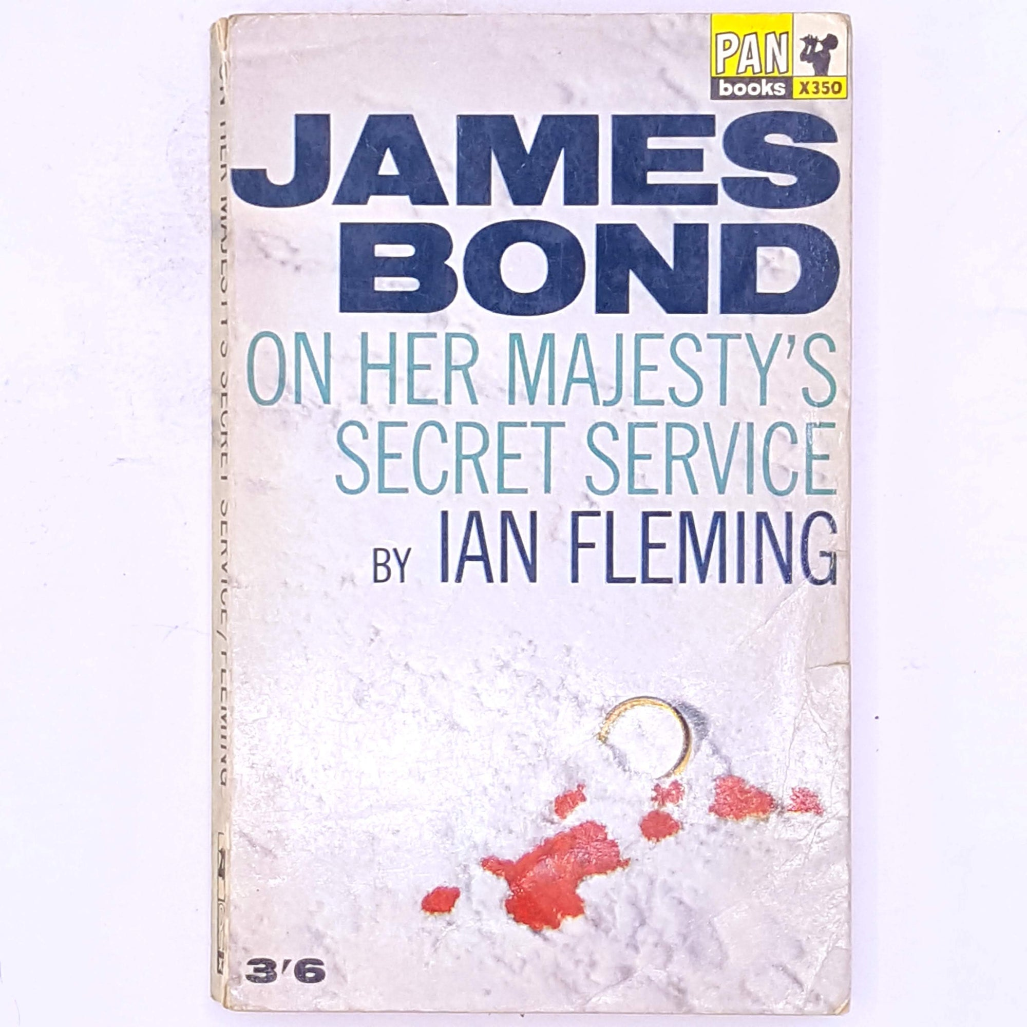 james-bond-spy-crime-mystery-British-secret-agent-antique-thrift-books-country-house-library-classic-old-thriller-secret-service-vintage-ian-fleming-on-her-majesty's-secret-service-decorative-patterned-007-
