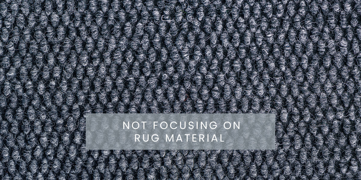 Not focusing on rug material