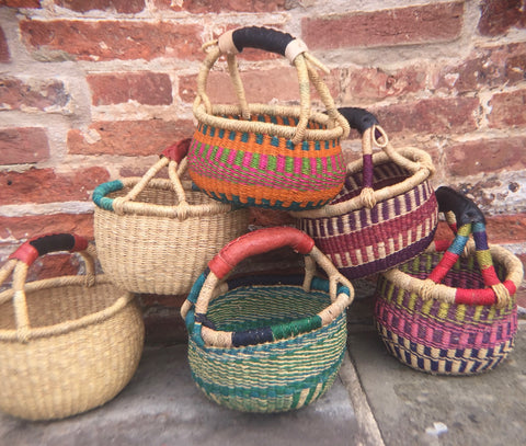 Colourful African Bolga Baskets against Brick Wall
