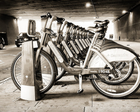 Boris bikes under bridge