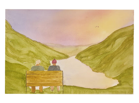 Old couple watching sunset over loch