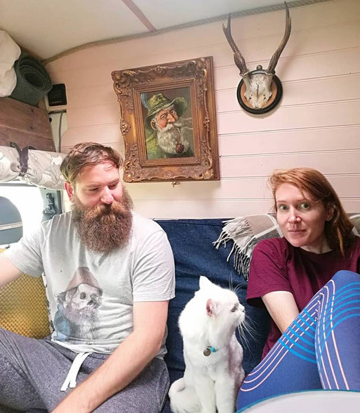 Stef Burgon and husband with their white persian rescue cat Frank in a campervan