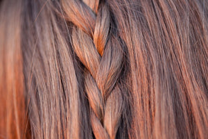 Close up image of light brown hair with simple braid down the centre of the hair. Illustrating natural full bodied volume that can be achieved with LUSHIERE CLIP IN HAIR EXTENSIONS