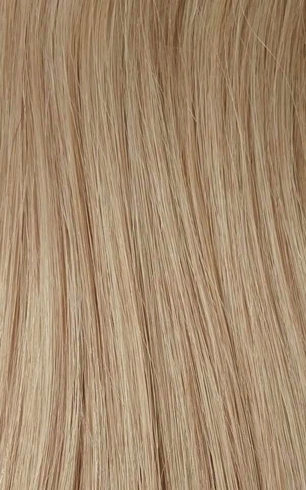 Close up image of LUSHIERE clip in hair extensions blonde colour #14 warm blonde taken in natural light