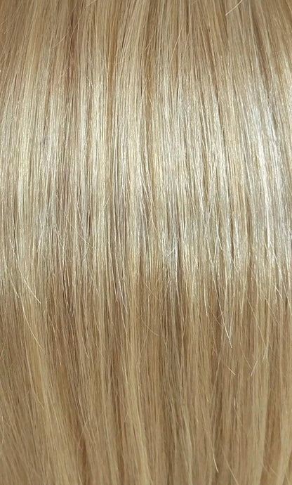 Close up image of LUSHIERE clip in hair extensions blonde colour #16 dirty blonde taken in natural light