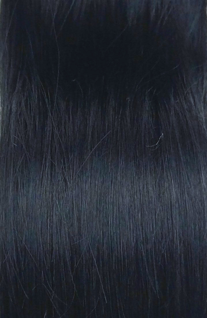 Close up image of LUSHIERE clip in hair extensions in black colour #1 taken in natural light
