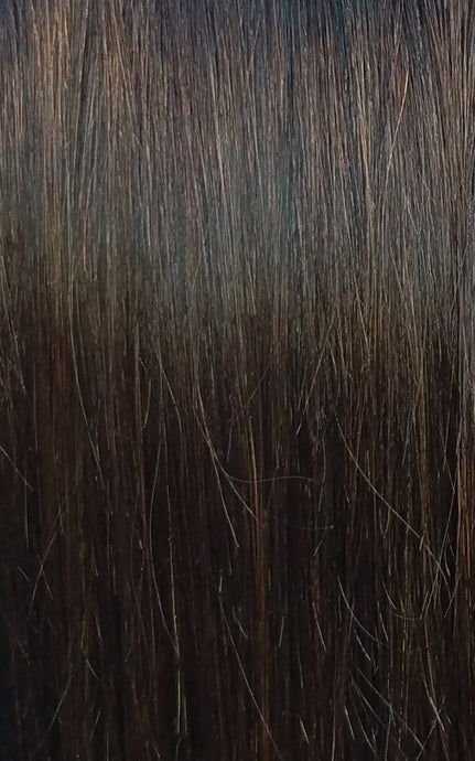 Close up image of LUSHIERE clip in hair extensions in brunette colour #2 chocolate brown taken in natural light