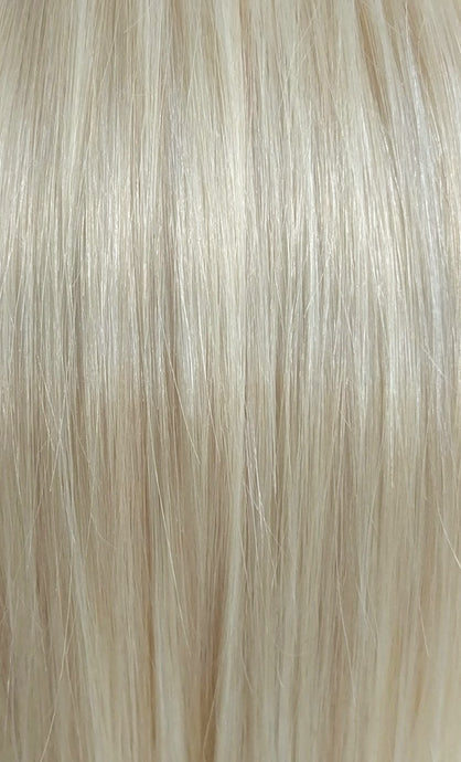 Close up image of LUSHIERE clip in hair extensions blonde colour #60 platinum white blonde taken in natural light