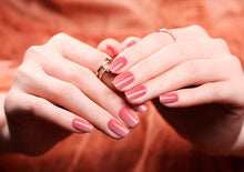 Image of manicured hands wearing nail wraps nail stickers in Pink Gradient design