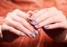 Image of manicured hands wearing nail wraps nail stickers in Tropical White design