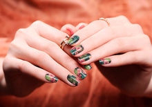 Image of manicured hands wearing nail wraps nail stickers in Tropical Green design