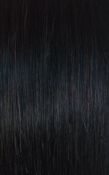 image of natural black LUSHIERE clip in hair extensions with warm undertones