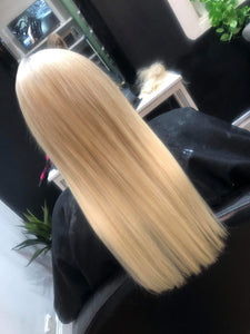 Image of customer from behind wearing LUSHIERE clip in hair extensions in blonde colour #60 platinum blonde