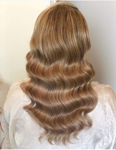 Image of customer from behind wearing LUSHIERE clip in hair extensions in blonde colour #16 dirty blonde