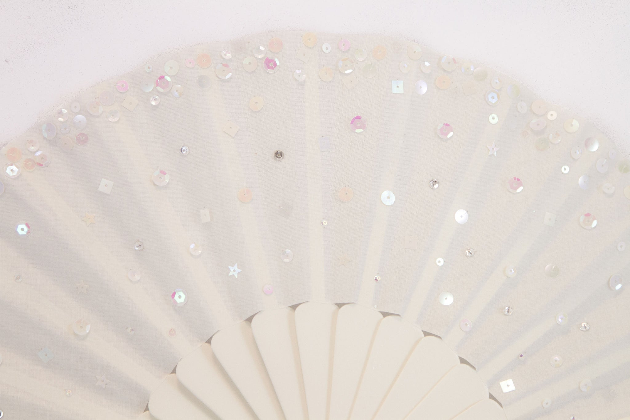 Cream handmade fan adorned with hand sewn sequins