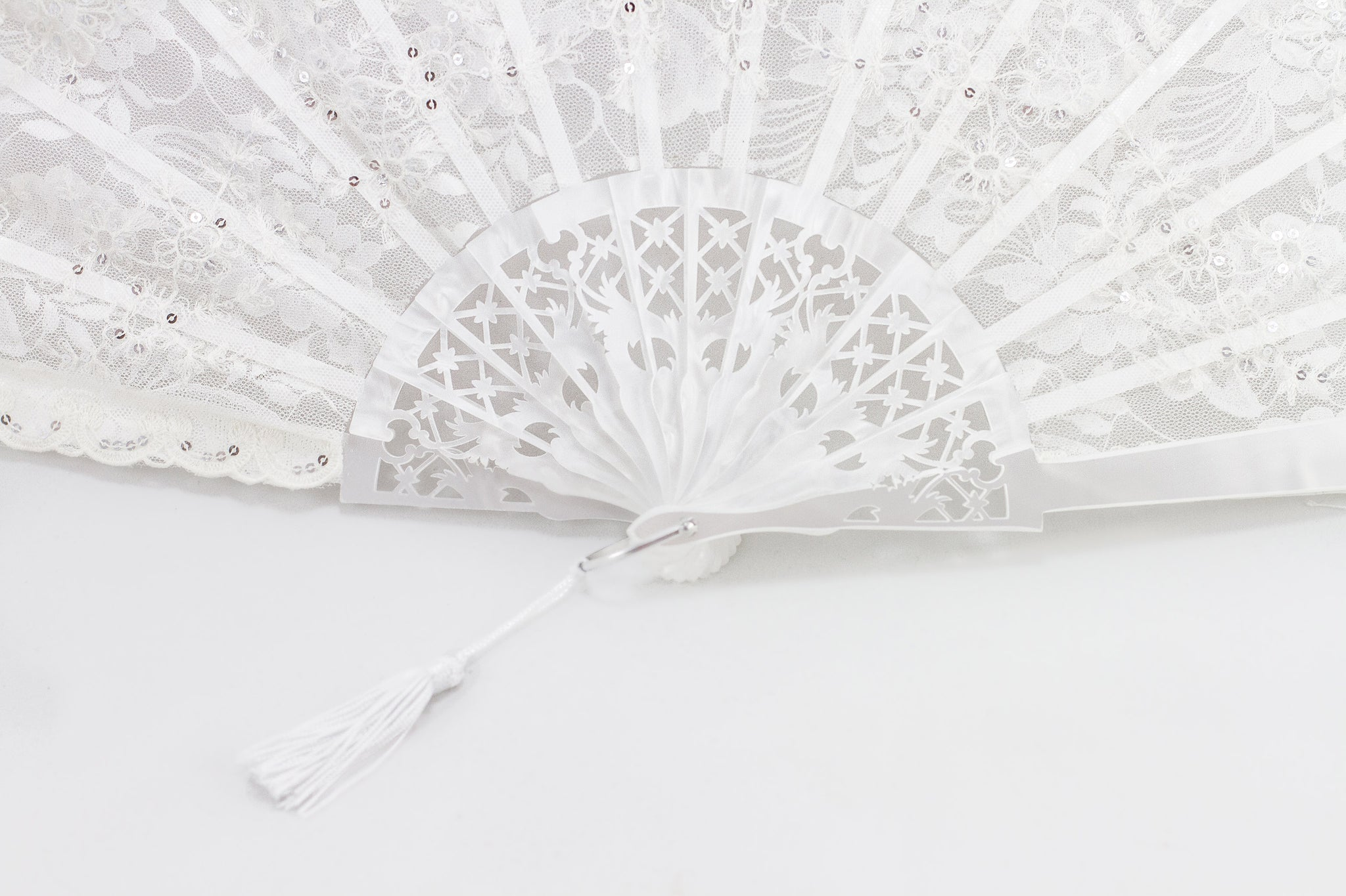 Atlanta Rockcocos handmade finest white lace fan adorned with hand sewn sequin close up