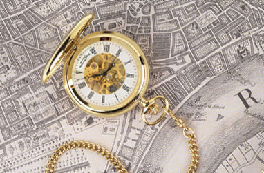 Gold H4 pocket watch resting on Greenwich London map