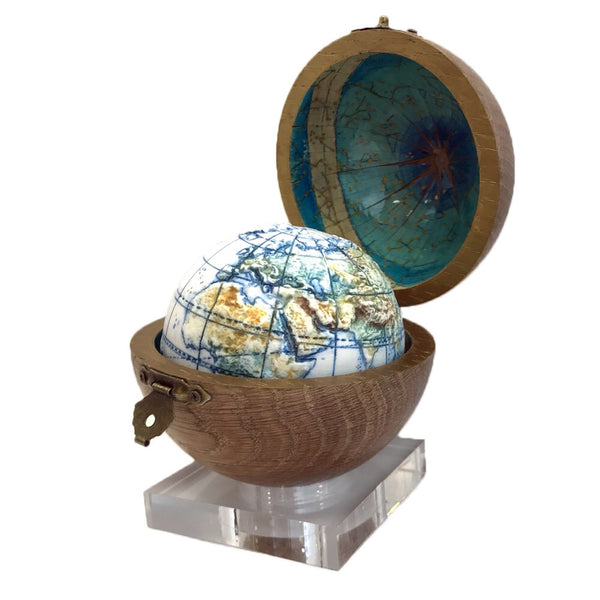 Porcelain globe in wooden box