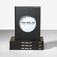 The Moon official exhibition book stacked